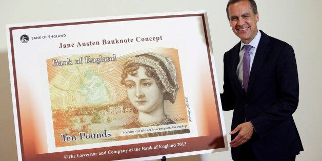 Mark Carney, governor of the Bank of England, stands alongside the concept design for the new Bank of...