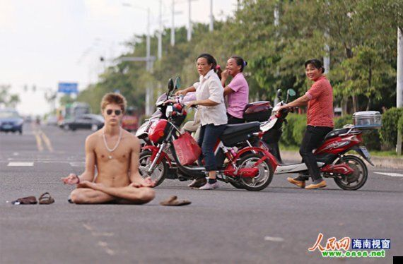 Naked Man Causes Chaos On Busy Chinese Road
