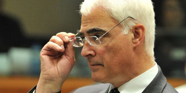 British Chancellor of the Exchequer Alistair Darling waits before an extraordinary EU Economy and Finance...