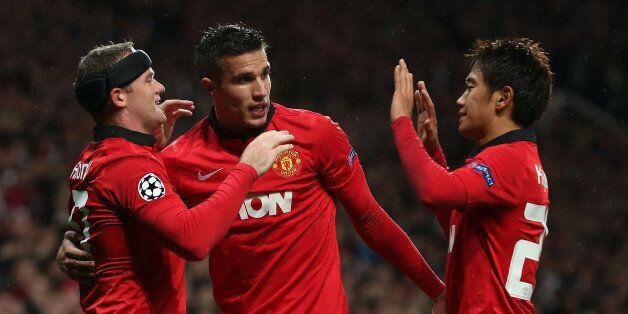 MANCHESTER, ENGLAND - SEPTEMBER 17: Wayne Rooney of Manchester United celebrates scoring their third...