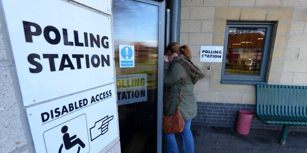 Voters arrive at Benchill Community Centre in Wythenshawe, Manchester, after voting in the Wythenshawe...