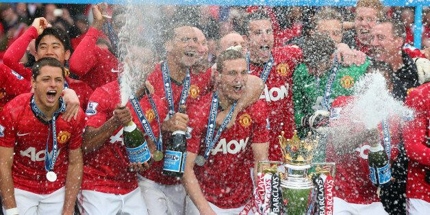 MANCHESTER, ENGLAND - MAY 12: The Manchester United players celebrate with the Premier League trophy...