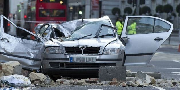 Car wrecked after masonry from a building