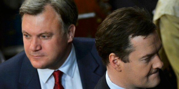 Britain's Chancellor of the Exchequer George Osborne (R) and shadow chancellor Ed Balls attend the State...