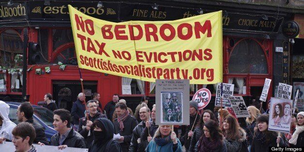 Protesters carry a Scottish Socialist Party banner on the anti bedroom tax protest in
