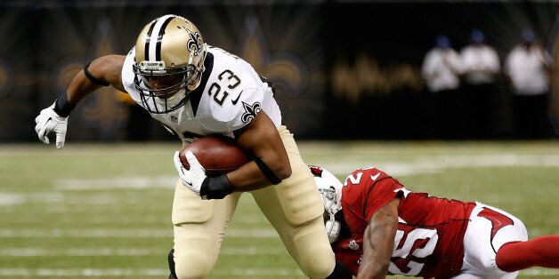 New Orleans Saints' Pierre Thomas avoids a tackle by Rashad