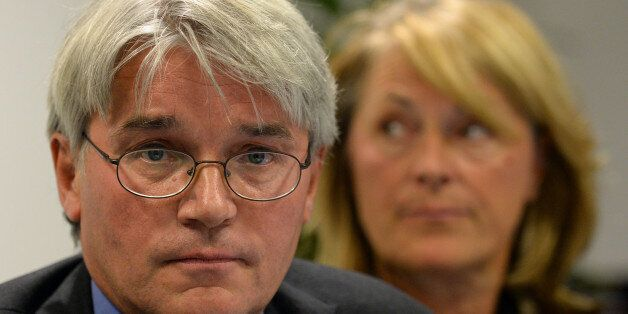 Andrew Mitchell and his wife Dr Sharon Bennett during a press conference in London, as he gives his reaction...