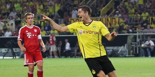 DORTMUND, GERMANY - JULY 27: Robert Lewandowski (R) of Dortmund celebrates during the DFL Supercup match...