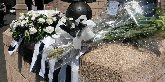 Flowers and football shirts around the Sir Bobby Robson statue outside Newcastle football ground after...