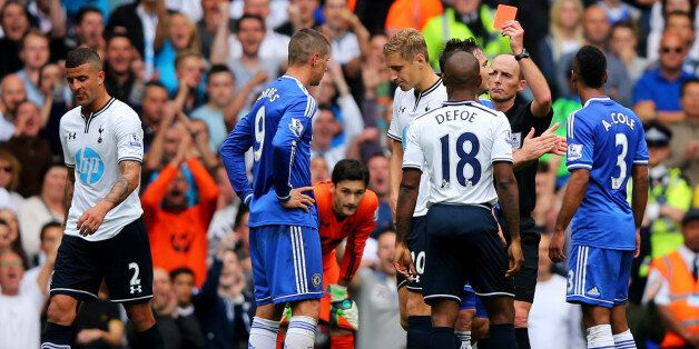 LONDON, ENGLAND - SEPTEMBER 28: Fernando Torres of Chelsea (9) is shown the red card by referee Mike...