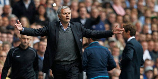 Chelsea's Portuguese manager Jose Mourinho gestures from the touchline during the English Premier League...