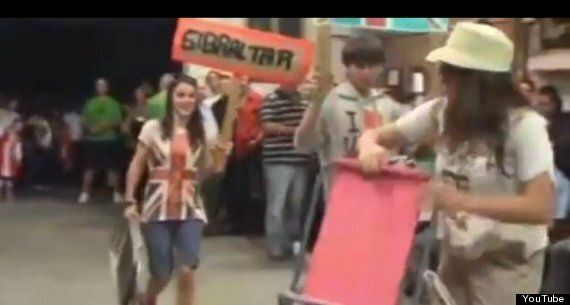 Spanish Festivalgoers Stage 'Performance' Of Gibraltar Invasion, Shooting