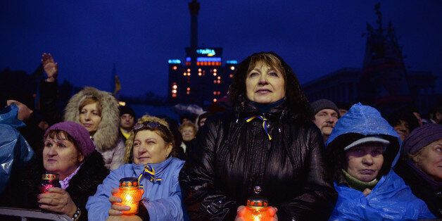 KIEV, UKRAINE - FEBRUARY 22: People react Independence square following the announcement that Ukrainian...