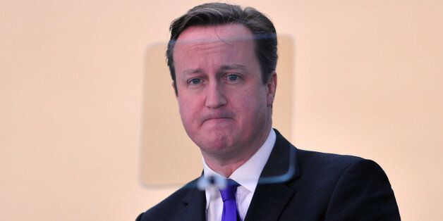 British Prime Minister David Cameron stands behind a teleprompter as he delivers a speech on Scottish...