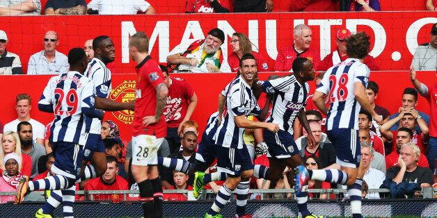 MANCHESTER, ENGLAND - SEPTEMBER 28: Saido Berahino (2nd right) of West Bromwich Albion celebrates with...