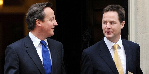 Prime Minister David Cameron (left) and Deputy Prime Minister Nick Clegg, leave 10 Downing Street, London,...