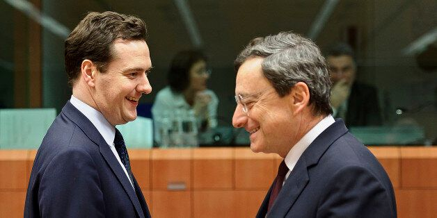 George Osborne, U.K. chancellor of the exchequer, left, speaks with Mario Draghi, president of the European...