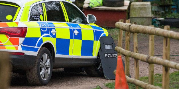 Police at the scene at Keepers Cottage Stud in Waverley Lane, Farnham, Surrey, where two women and four...
