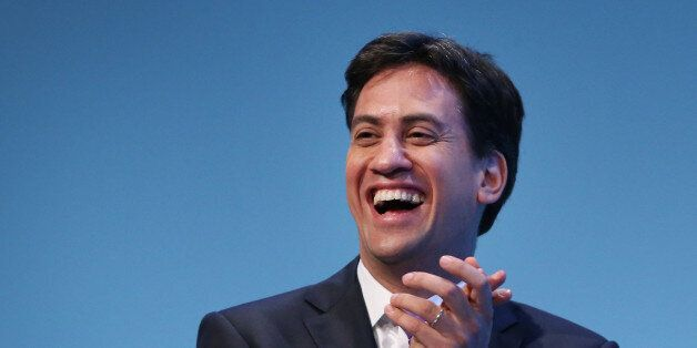 BRIGHTON, ENGLAND - SEPTEMBER 25: Party leader Ed Miliband laughs during a speech by deputy leader Harriet...