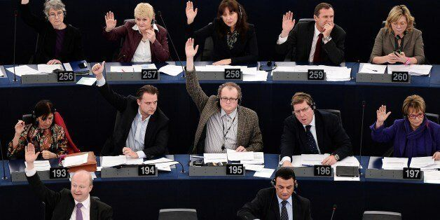 Members of the European Union parliament take part in a vote during a plenary session at the European...