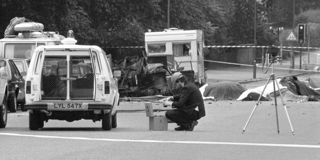 File photo dated 20/07/82 of a police photographer at the scene of the car bomb, in which four soldiers...
