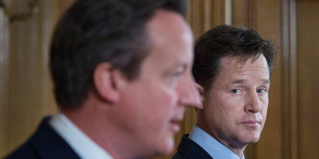 Britain's Prime Minister David Cameron (L) and Deputy Prime Minister Nick Clegg address a press conference...