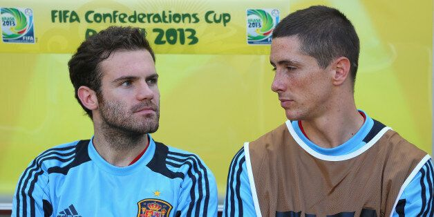 FORTALEZA, BRAZIL - JUNE 23: Juan Mata and Fernando Torres of Spain look on prior to the FIFA Confederations...