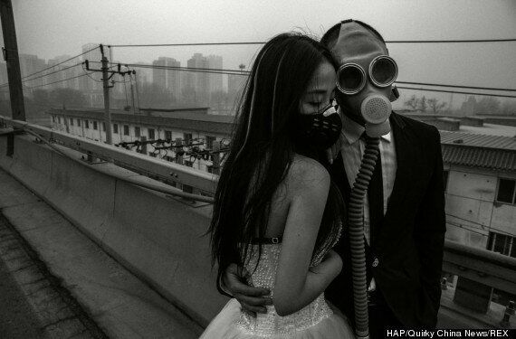 Beijing Bride And Groom Pose In Gas Masks In China