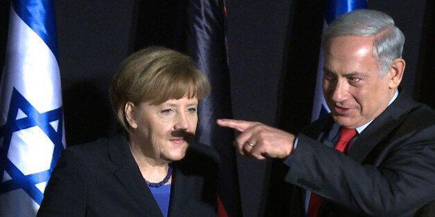 In this video-grab, German Chancellor Angela Merkel (L) and Israeli Prime Minister Benjamin Netanyahu...