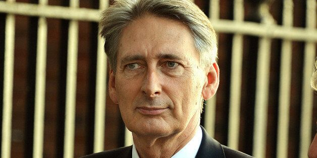 Foreign Secretary Philip Hammond leaves Downing Street, London, where Prime Minister David Cameron chaired...