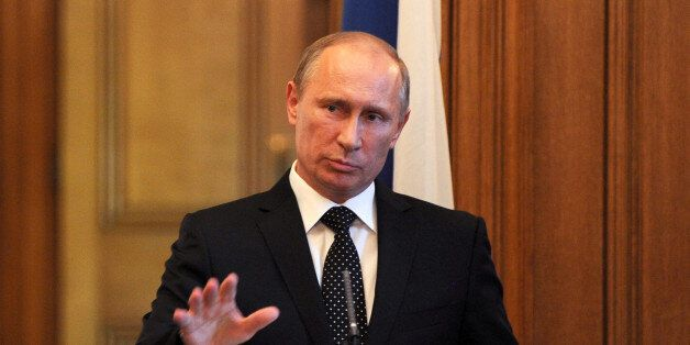 Russian President Vladimir Putin speaks during a press conference inside 10 Downing Street,