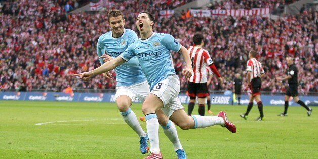 Manchester City's Samir Nasri (centre) celebrates scoring their second goal of the