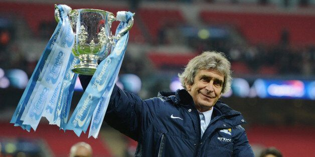 LONDON, ENGLAND - MARCH 02: Manuel Pellegrini, manager of Manchester City celebrates victory with the...
