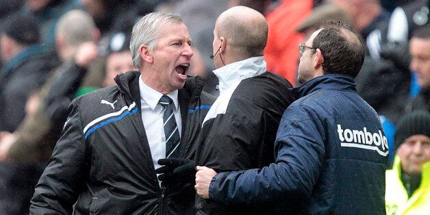 Newcastle United's manager, Alan Pardew (L) gestures towards Sunderland's manager, Martin O'Neill (R)...