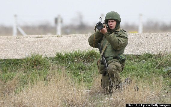 Incredible Pictures Show Unarmed Ukrainian Soldiers Confronting Heavily Armed Russian