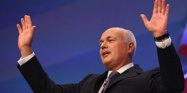MANCHESTER, ENGLAND - OCTOBER 03: Iain Duncan Smith, Secretary of State for Work and Pensions takes applause...