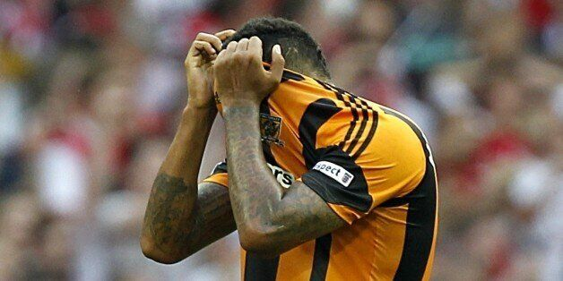 Hull City's Tom Huddlestone reacts after the