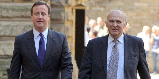 British Prime Minister David Cameron arrives with Business Secretary Vince Cable to speak to members...
