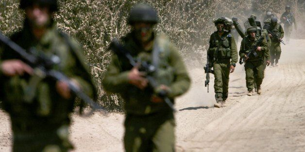 LEBANON BORDER, ISRAEL - AUGUST 01: (ISRAEL OUT) Israeli soldiers move toward the Lebanese border during...