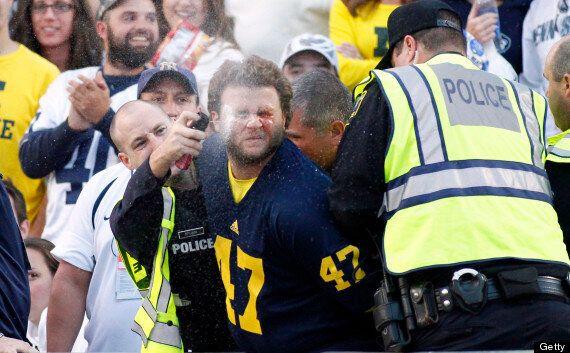 Handcuffed Michigan Fan Pepper Sprayed In Face By Policeman