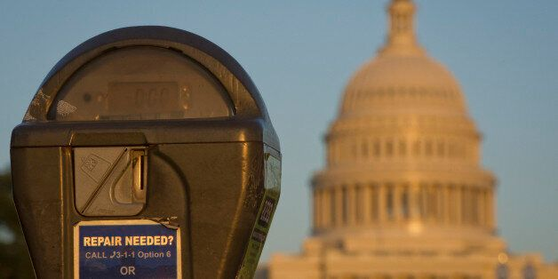 The US Congress building is seen behind a parking meter in Washington, DC, October 14, 2013. The crisis...