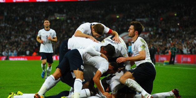 LONDON, ENGLAND - OCTOBER 15: Wayne Rooney of England celebrates with team mates after scoring his team's...