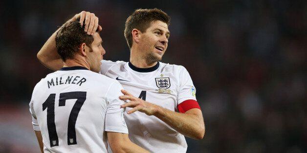 LONDON, ENGLAND - OCTOBER 15: James Milner and Steven Gerrard of England celebrate at the final whistle...