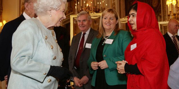 Queen Elizabeth II meeting Malala Yousafzai during a Reception for Youth, Education and the Commonwealth...