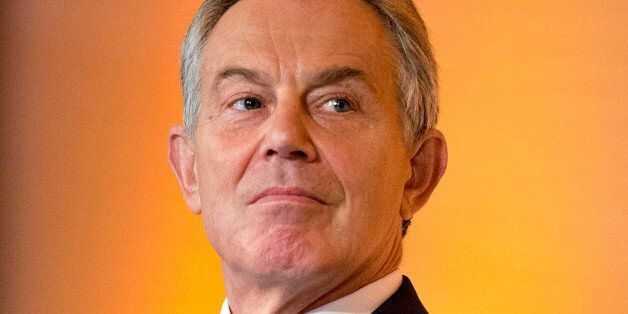 Tony Blair, former U.K. prime minister, listens during the World Food Prize Borlaug Dialogue in Des Moines,...