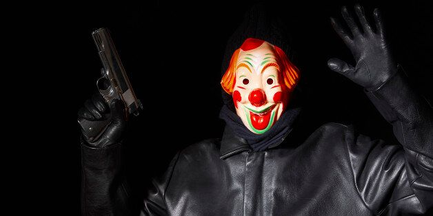The clown assassin struck at a family gathering (file