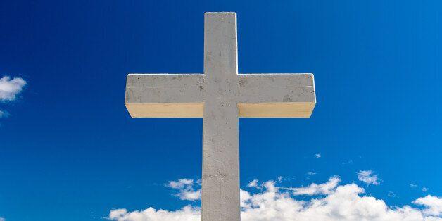 white cross against blue
