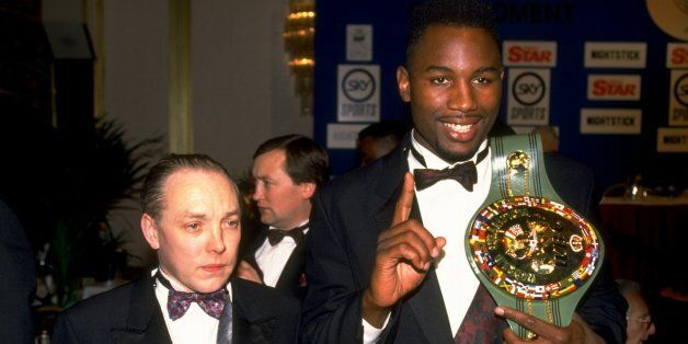 1992: Heavyweight boxer Lennox Lewis of Great Britain shows off his WBC belt with his manager Frank Maloney....