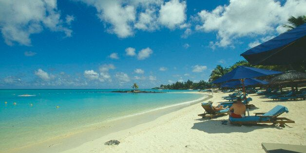 MAURITIUS Grand Bay The beach at the Mauritius Hotel. People on sun loungers and