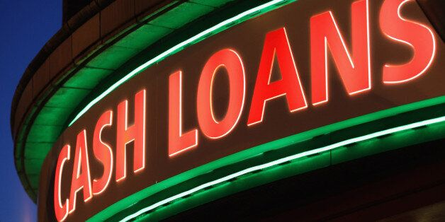 LONDON, ENGLAND - NOVEMBER 01: A sign outside a 'Speedy Cash' cash loans shop on Brixton High Street...